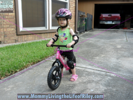 Riley riding the Strider PREbike