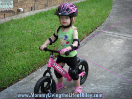 Riley riding her Strider PREbike