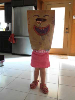 Riley in her new paper bag mask